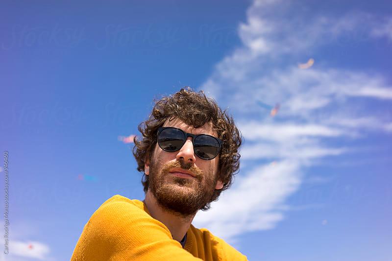Man with glasses by Carles Rodrigo Monzo for Stocksy United