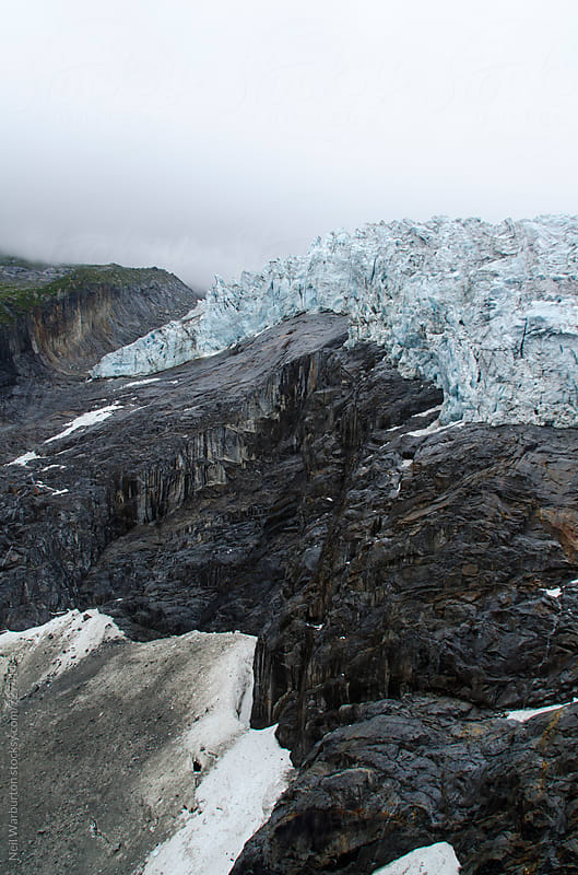 Retreating alpine glacier by Neil Warburton for Stocksy United