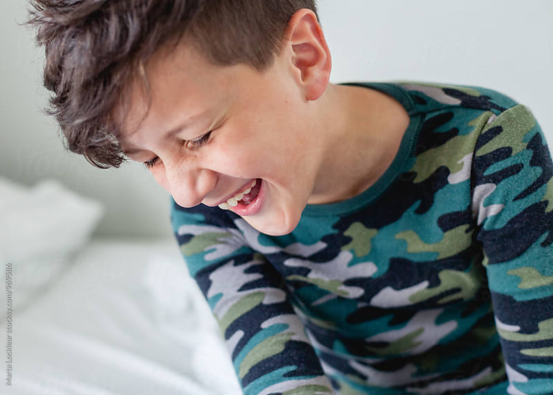 Boy laughing by Marta Locklear for Stocksy United