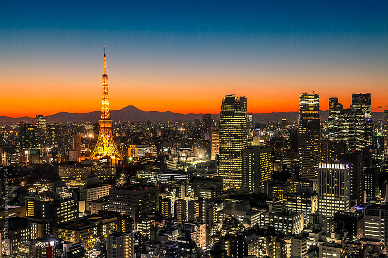 Panorama of Tokyo at sunset, featuring Mt. Fuji by Tom Uhlenberg for Stocksy United