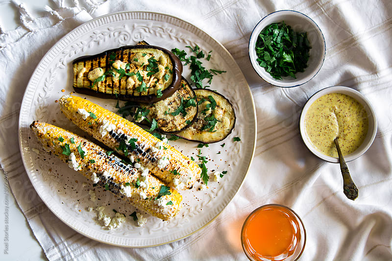 Grilled eggplant and Mexican street corn by Pixel Stories for Stocksy United