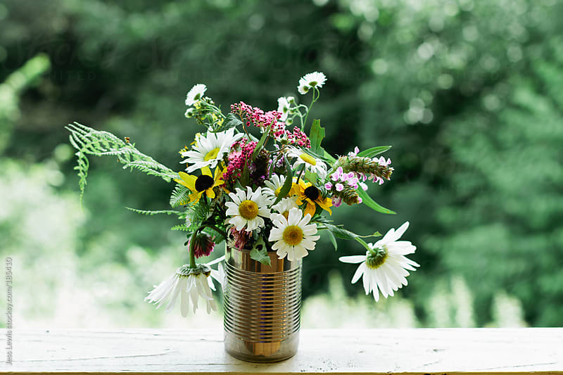 wild flower bouquet in tin can by Jess Lewis for Stocksy United