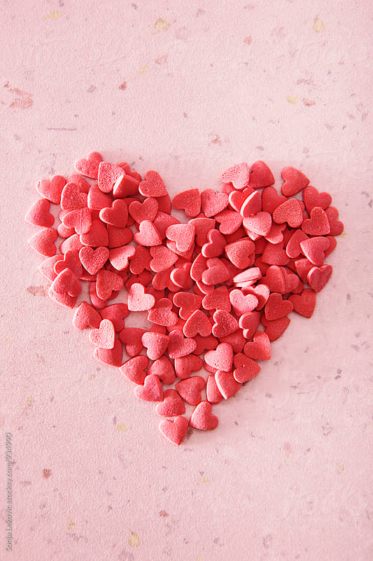 red heart made of many hearts by Sonja Lekovic for Stocksy United