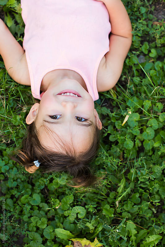 Overhead Shot of a Little Girl in the Grass by Mosuno for Stocksy United