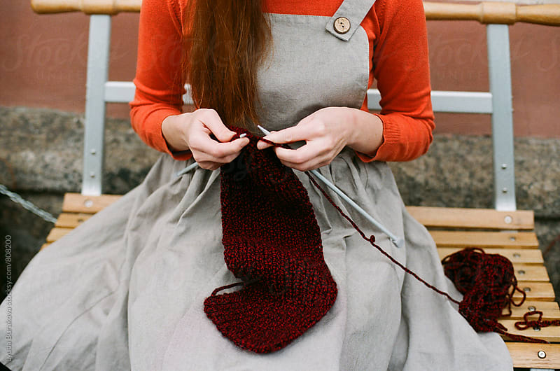 Close up shot of woman's hands knitting  by Lyuba Burakova for Stocksy United