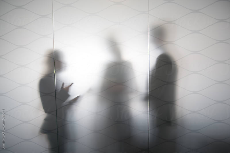 Silhouettes of Business People Talking  by Lumina for Stocksy United