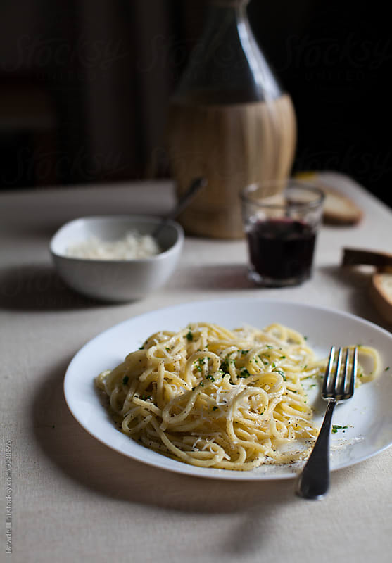 Spaghetti with olive oil and parmesan cheese by Davide Illini for Stocksy United