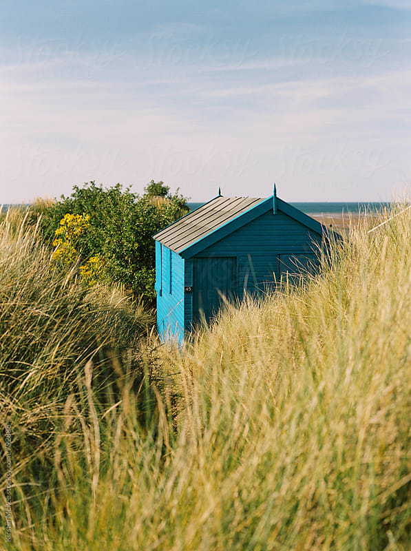 Blue beach hut in Norfolk by Kirstin Mckee for Stocksy United