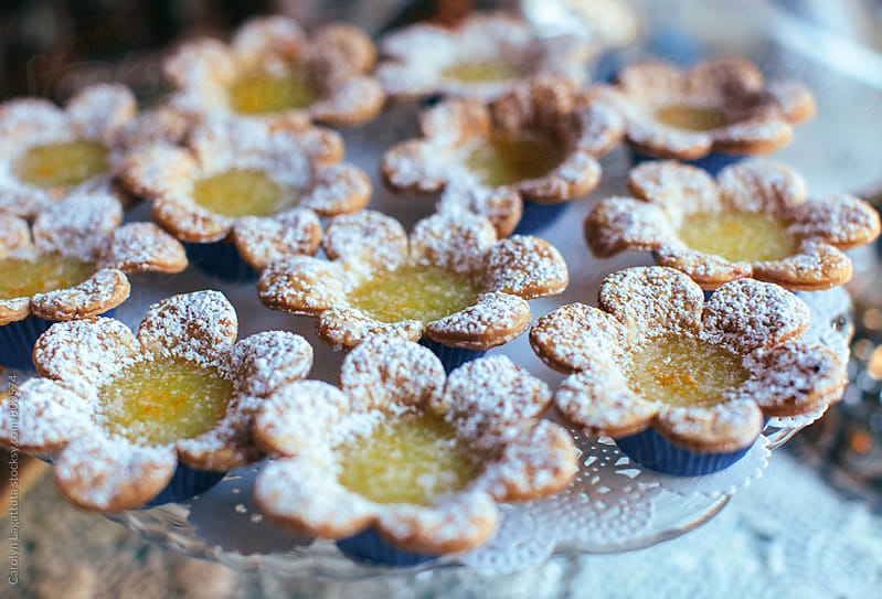 Lemon pastry in the shape of a flower with powdered sugar on top by Carolyn Lagattuta for Stocksy United