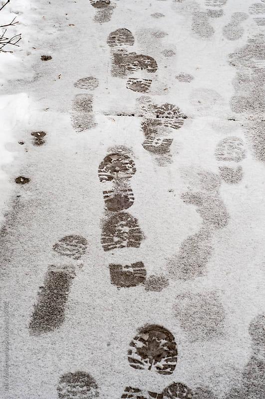 Footprints on the Sidewalk by Jeff Wasserman for Stocksy United