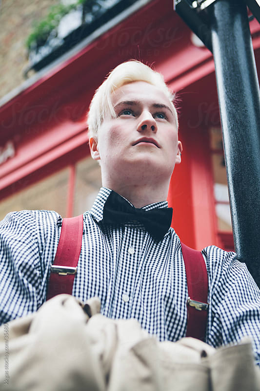 Trendy young man outside a shop in Soho London. by kkgas for Stocksy United