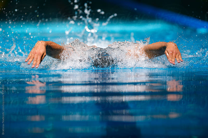 Male Swimmer Racing performing Butterfly Stroke by Bratislav Nadezdic for Stocksy United