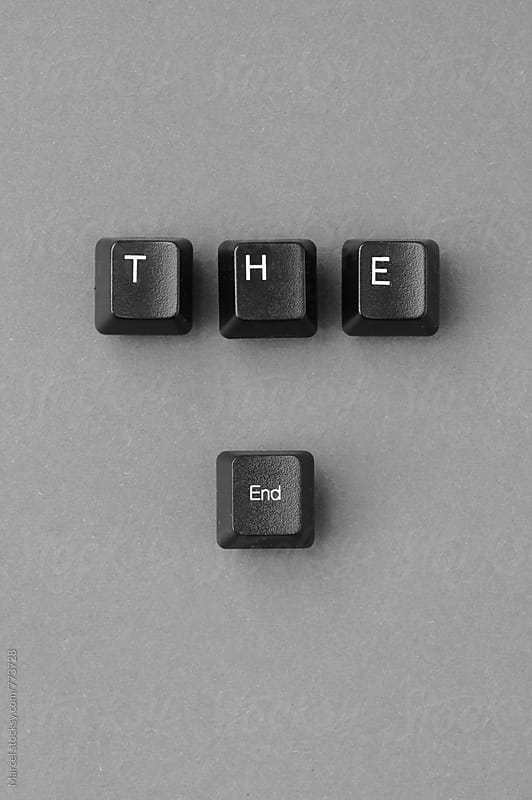 'The end' written with computer keyboard keys on a paper background by Marcel for Stocksy United