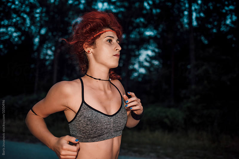 Young woman running outdoor by Boris Jovanovic for Stocksy United