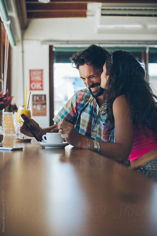 Young Couple Having Coffee by Mosuno for Stocksy United