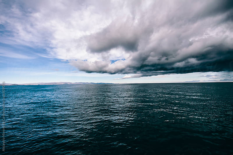 Cloud over a lake during a storm. Lake Titicaca, Bolivia - Peru by Alejandro Moreno de Carlos for Stocksy United