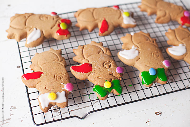 Iced gingerbread reindeer cookies for Christmas by Natalie JEFFCOTT for Stocksy United