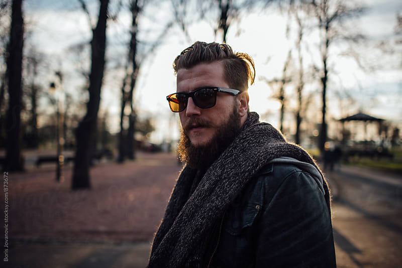Portrait of stylish bearded man in the city by Boris Jovanovic for Stocksy United
