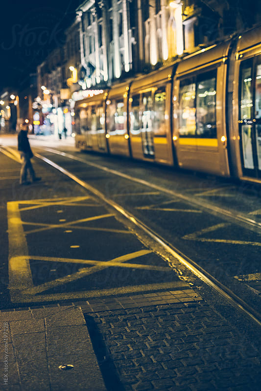 Dublin Street and Tram by Night by HEX. for Stocksy United