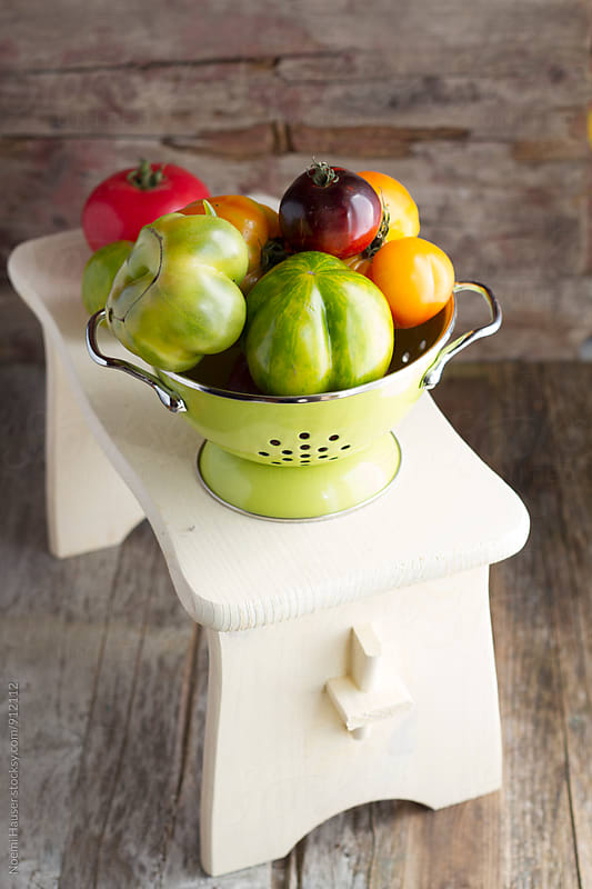 Tomatoes in sieve by Noemi Hauser for Stocksy United