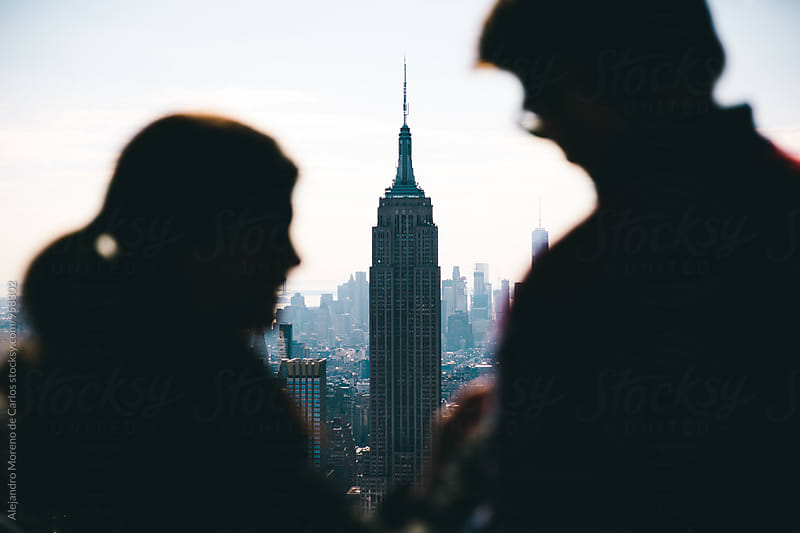 Silhouette of couple and view of the Empire State in the background. New York by Alejandro Moreno de Carlos for Stocksy United
