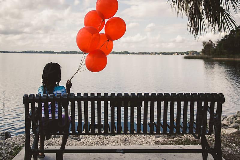 Girl with Red Balloons by Gabriel (Gabi) Bucataru for Stocksy United