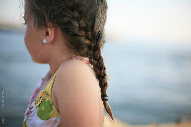 Girl With Braids At The Beach by ALICIA BOCK for Stocksy United