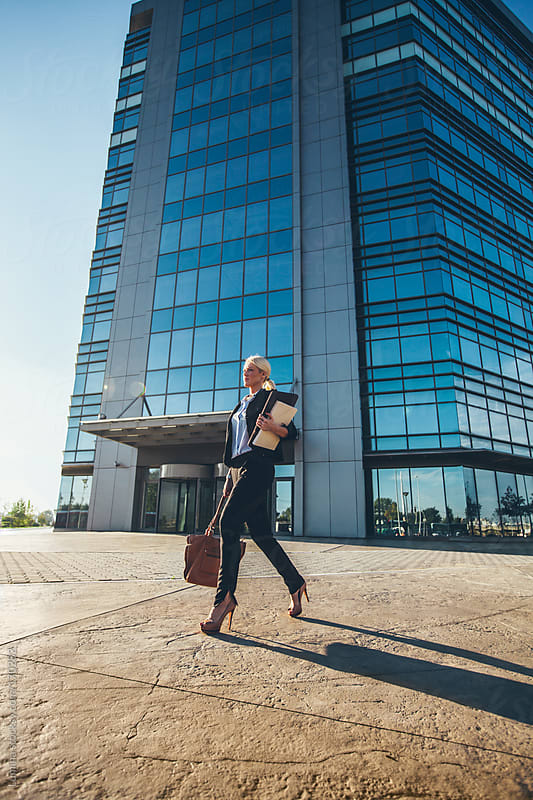 Businesswoman Walking Outdoors by Lumina for Stocksy United