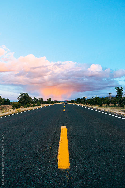 Country road heading the storm by Good Vibrations Images for Stocksy United