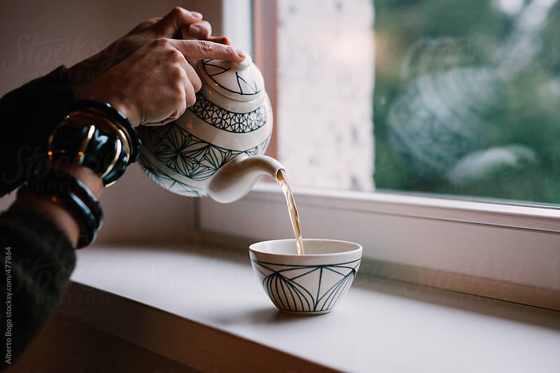 Woman Pouring Tea by Alberto Bogo for Stocksy United