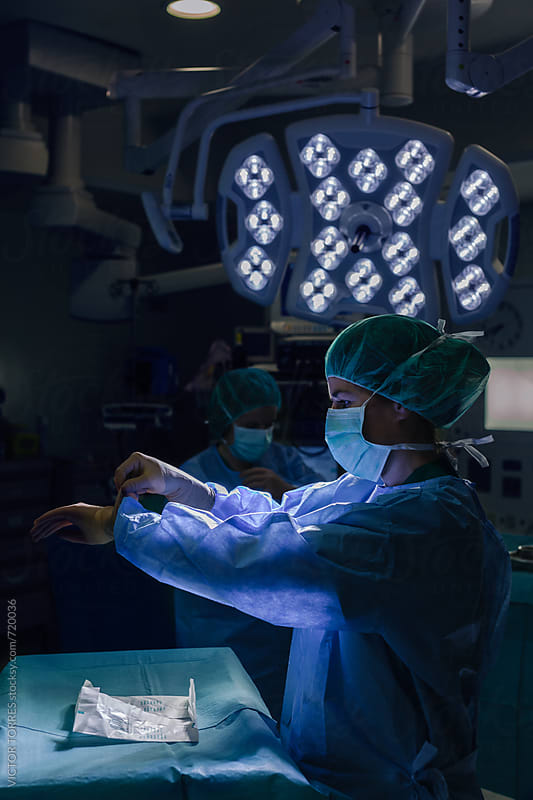 Surgeon Checking Wearing Gloves Before Operation by Victor Torres for Stocksy United