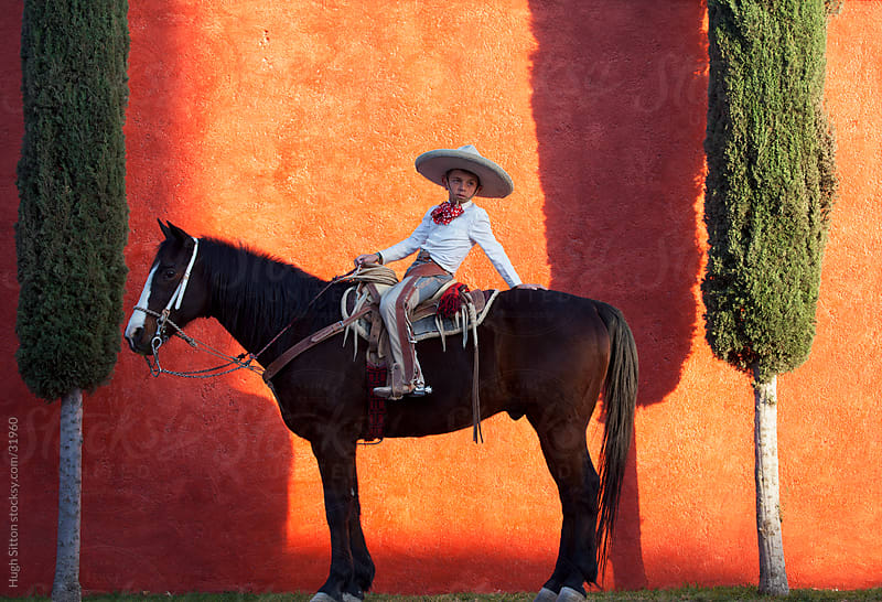 Young Mexican Cowboy sittng on his horse. Mexico by Hugh Sitton for Stocksy United