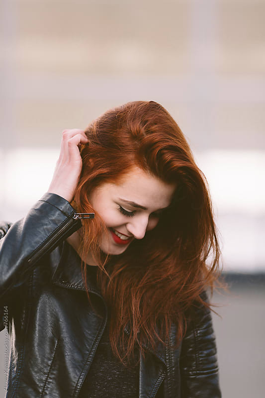 Happy young woman with red hair by Alexey Kuzma for Stocksy United