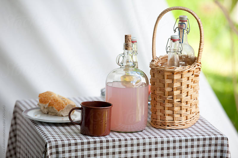 home made pink lemonade and french bread at a picnic by Lee Avison for Stocksy United