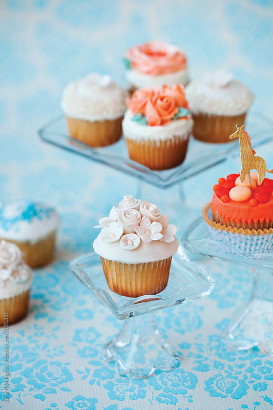 Party Cupcakes on Blue Background by Sara Remington for Stocksy United