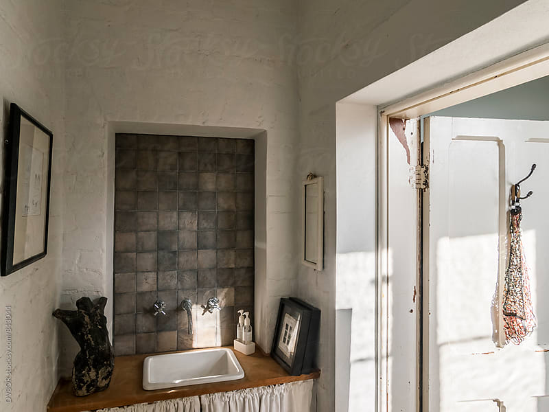 Wash room in a vintage, retro, hipster inspired English House interior by DV8OR for Stocksy United