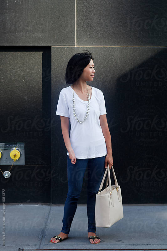 stylish woman on street  by Jennifer Brister for Stocksy United
