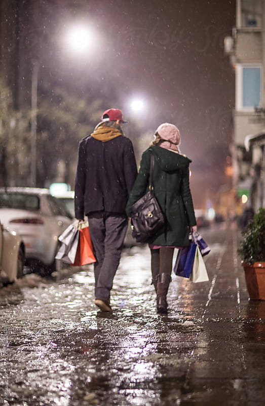 Couple Walking Down the Street at Night by Mosuno for Stocksy United