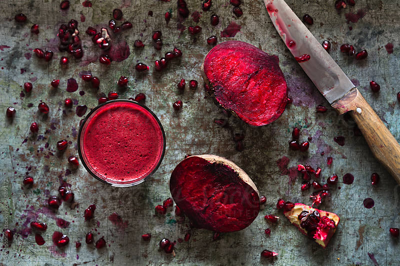 Beetroot and pomegranate juice by Pixel Stories for Stocksy United