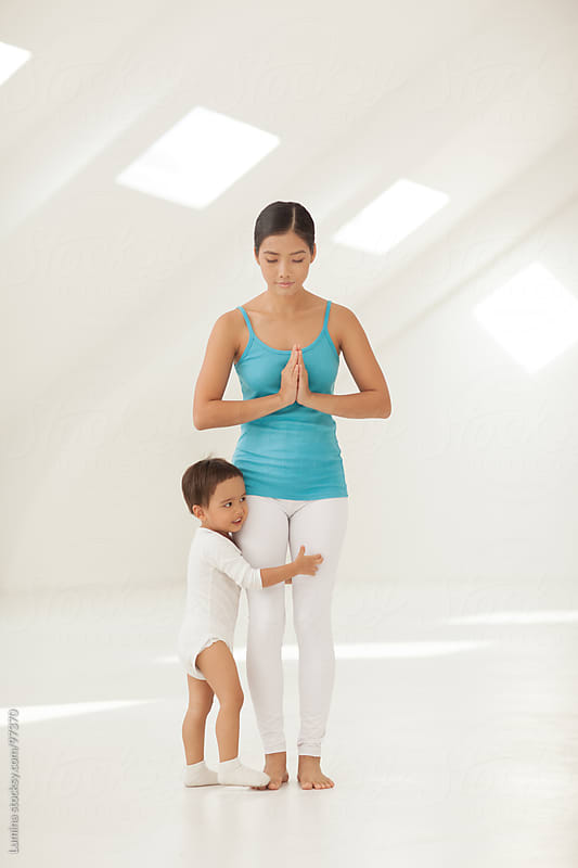 Mother and Child Doing Yoga by Lumina for Stocksy United