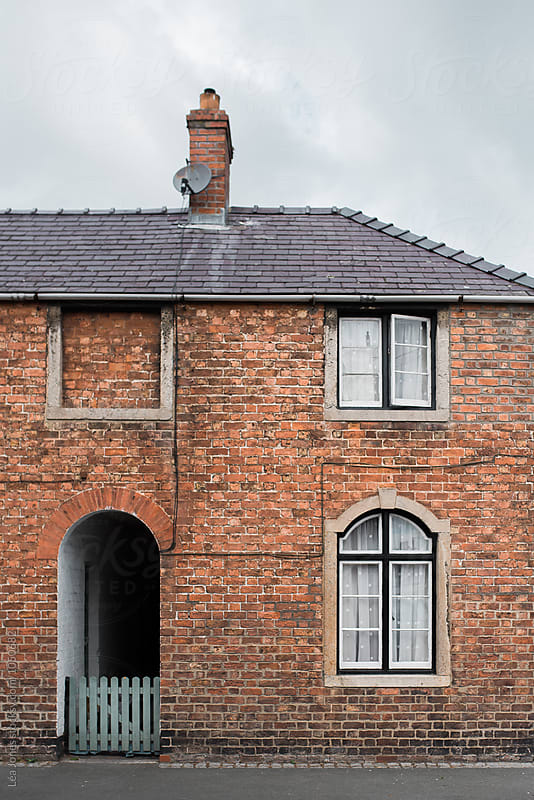 red brick house by Léa Jones for Stocksy United