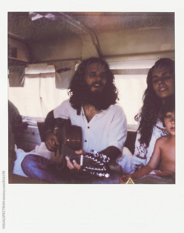 Polaroid of Young Hippie Family of Three Singing Inside Camper Van by Julien L. Balmer for Stocksy United
