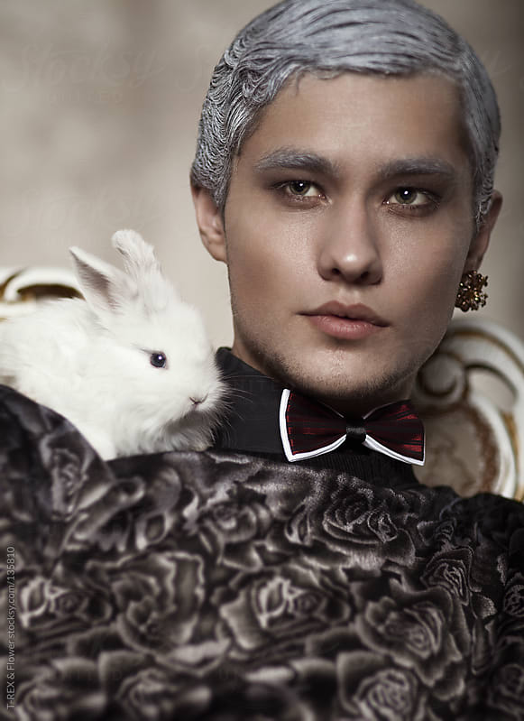 Young man with a rabbit by Danil Nevsky for Stocksy United