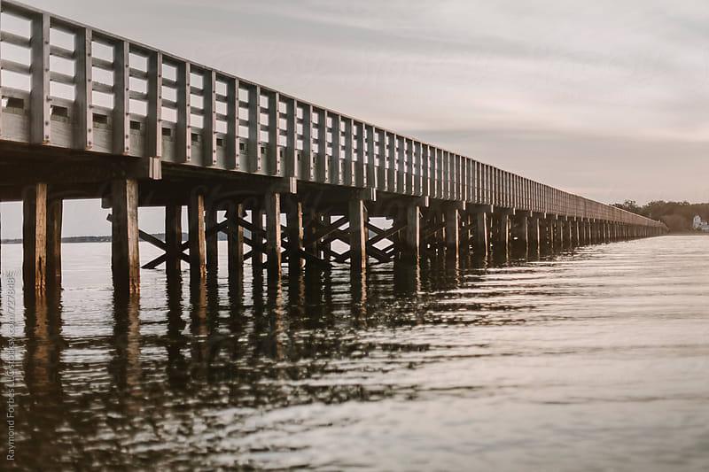 Wooden Bridge on Bay in Massachusetts by Raymond Forbes LLC for Stocksy United