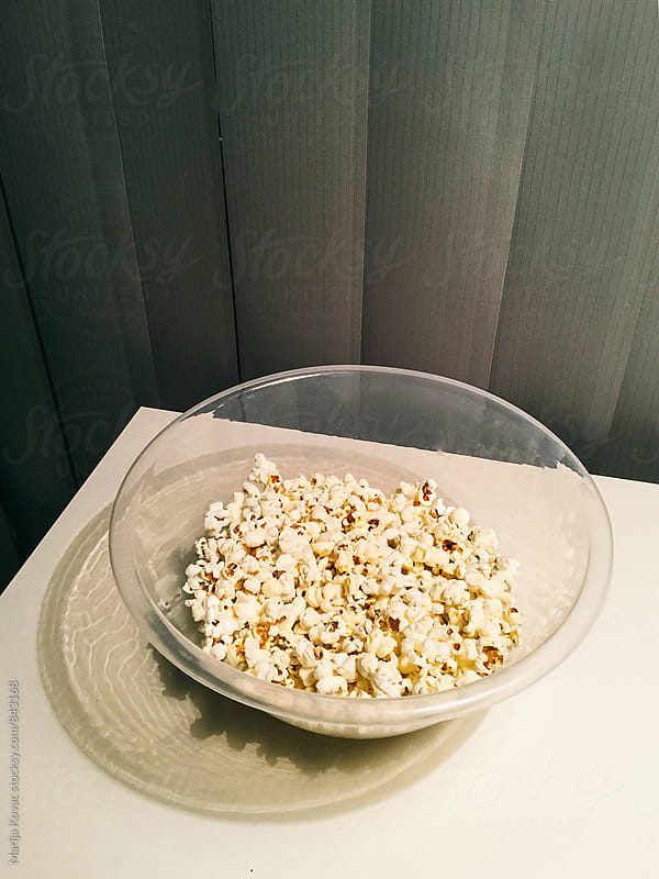 Popcorn in a bowl - vertical by Marija Kovac for Stocksy United