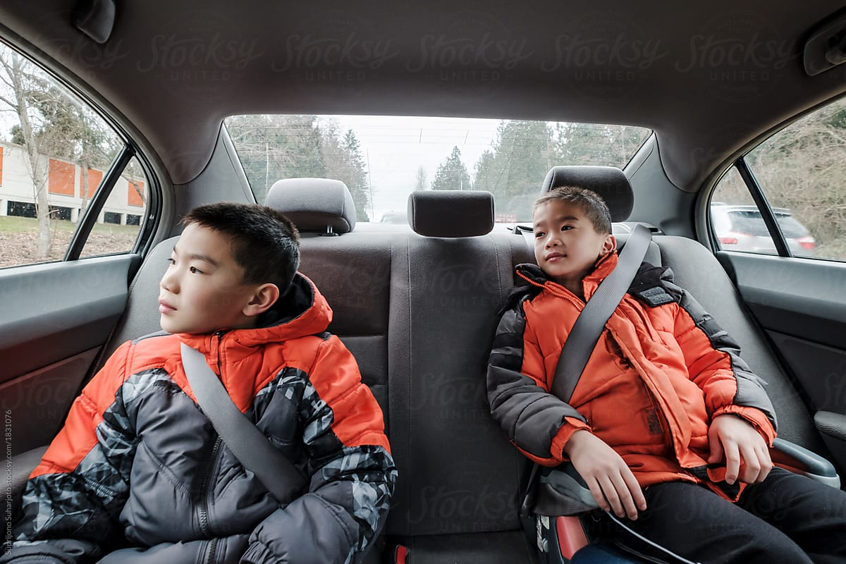 Asian Kids Sitting in the Car Looking Outside by Take A Pix Media - Car,  Travel - Stocksy United