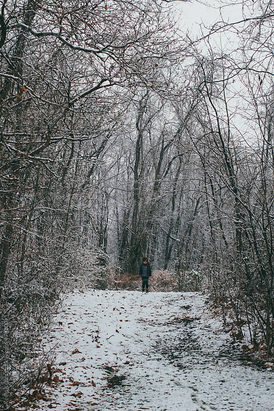Young Boy Standing on a Trail in Winter by Kevin Keller for Stocksy United