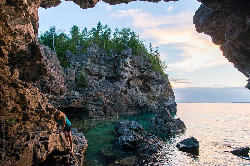 Girl Exploring Grotto Sea Cave on Georgian Bay Bruce Peninsula National Park Tobermory Ontario by JP Danko for Stocksy United