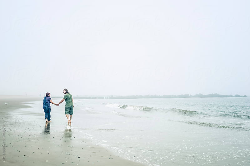 Couple enjoying on the beach by GIC for Stocksy United