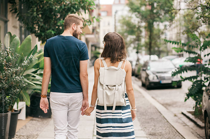 Couple on the date holding hands by Irina Efremova for Stocksy United